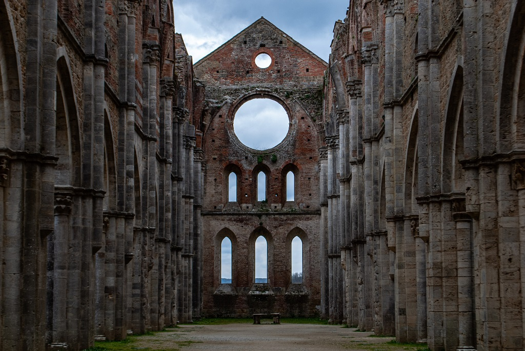 The interiors of the roofless San Galgano Abbey in Tuscany