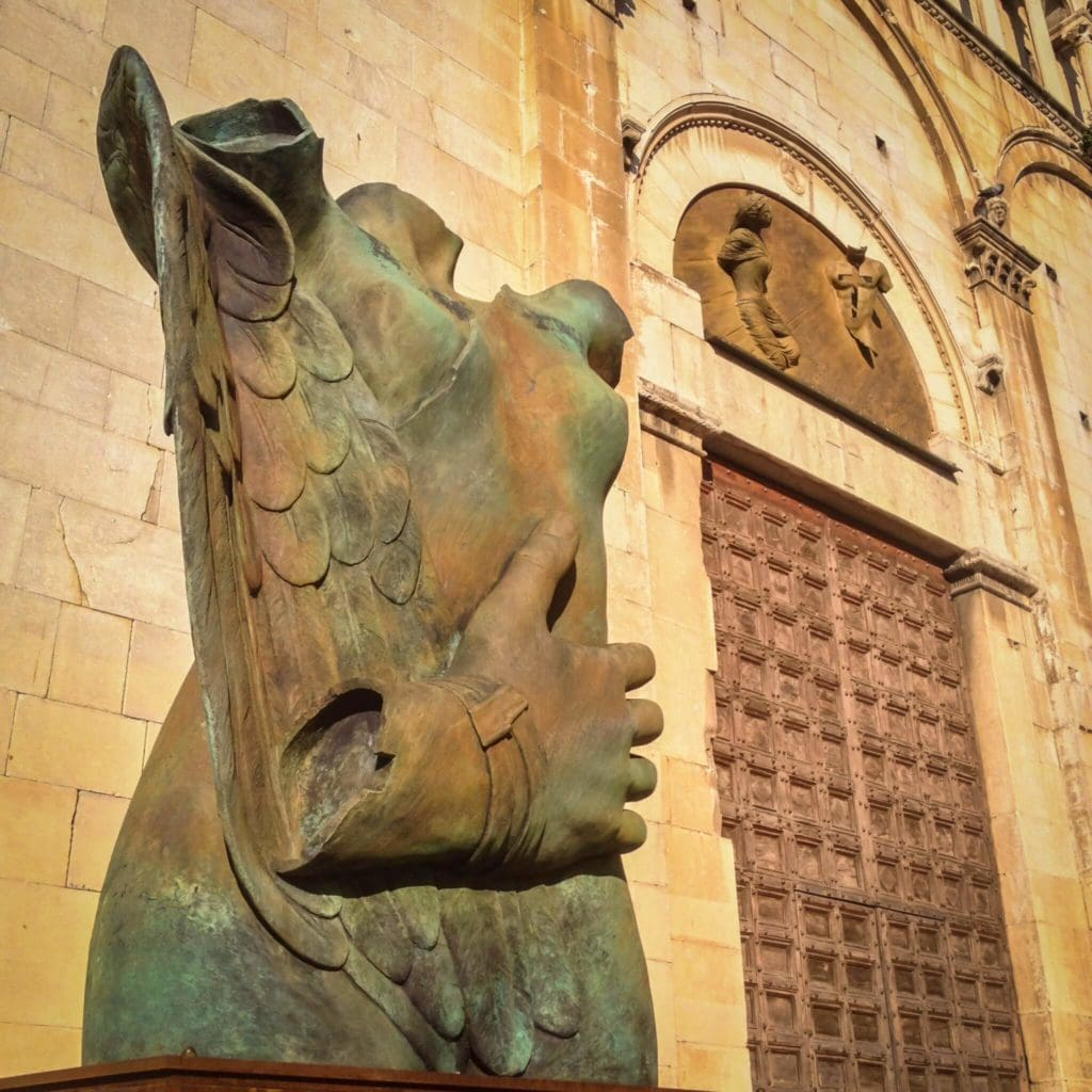 A sculpture of Mitoraj on the steps of the Church of Saint Agostino Pietrasanta Tuscany