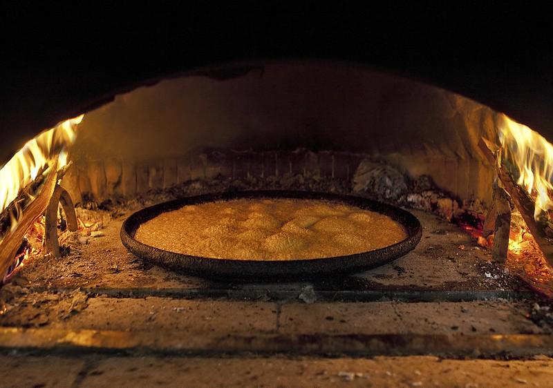 Farinata in the wooden oven