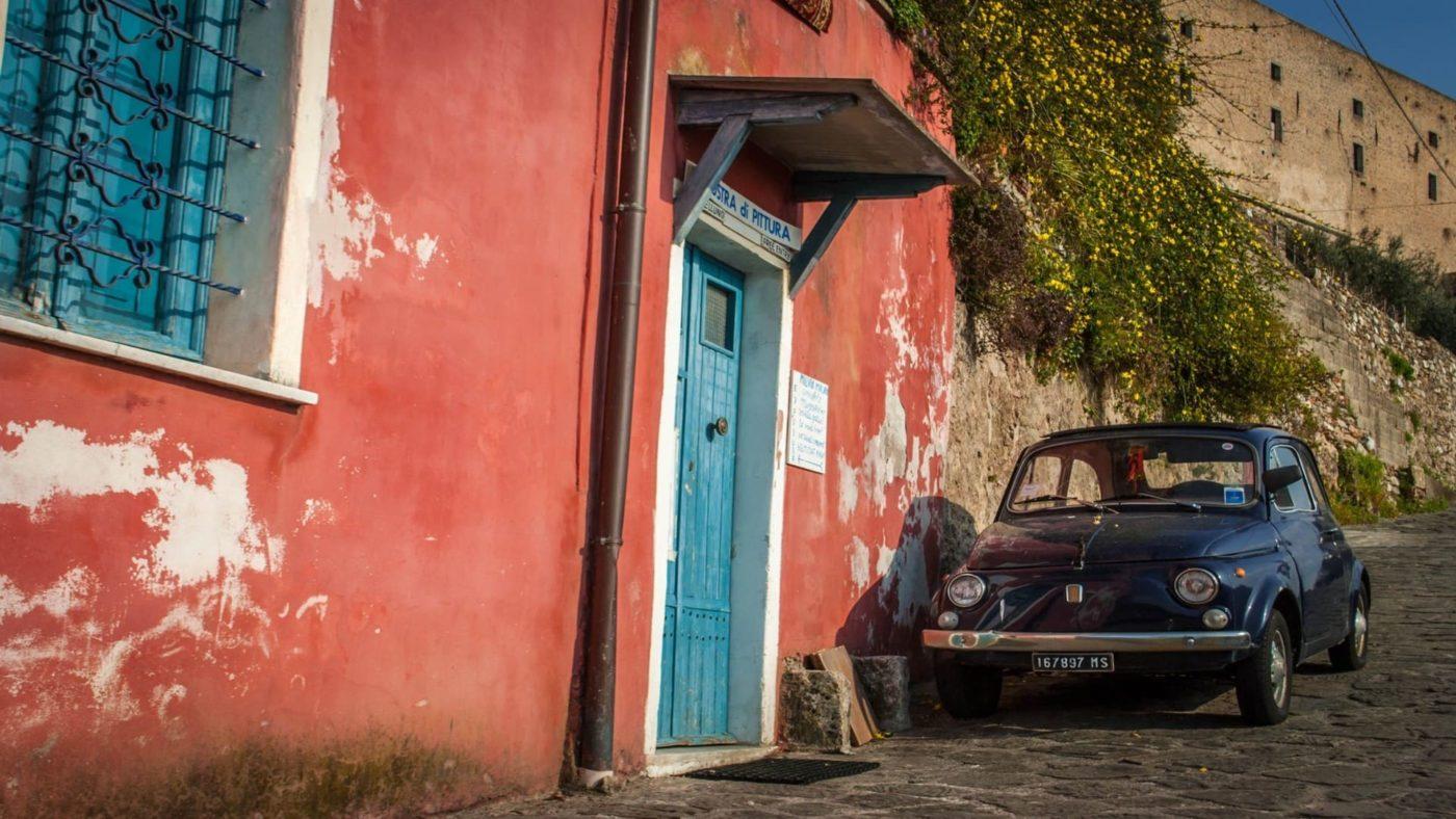 Fiat 500 under at the feet of Malaspina Castle in Massa Carrara
