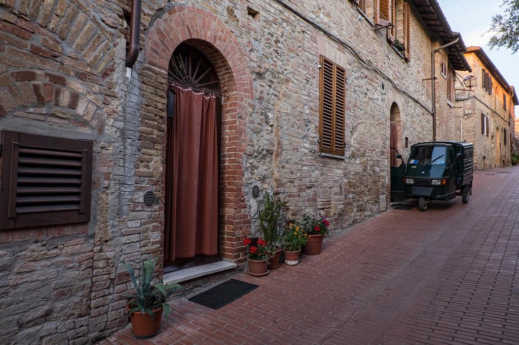 street of San Gimignano with the Ape Piaggio car