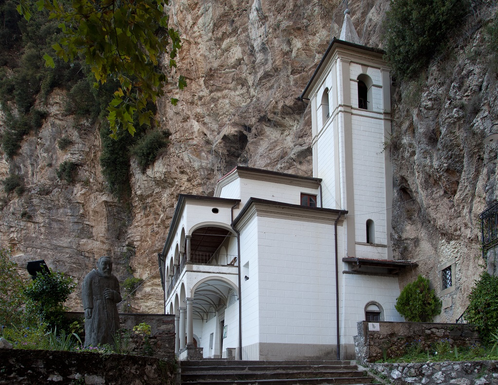 Eremo di Calomini nestled in the rock in Tuscany